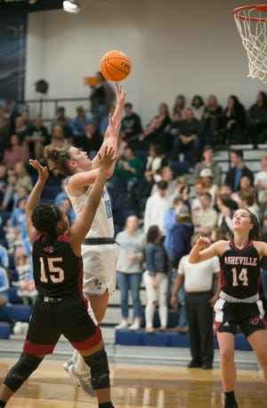 Enka's Hadleigh Dill went up for a basket as Enka's girls faced off against Asheville High on Dec. 13, 2019, at Enka.  Enka took the win with a final score of 69-61.