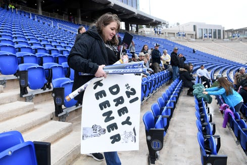 Robbinsville's Drey Keener's mom, Lisa, finds a seat at Wallace Wade Stadium for the NCHSAA 1A state championship game in Durham on Dec. 14, 2019.