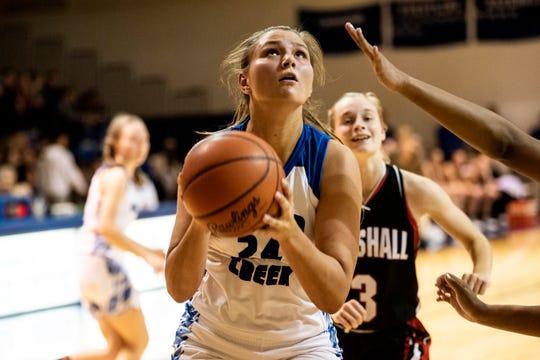 Harper Creek senior Maddie Alexander (24) shoots a basket on Friday, Dec. 13, 2019 at Harper Creek High School in Battle Creek, Mich. Harper Creek defeated Marshall 38-30.