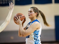 Harper Creek senior Maddie Alexander (24)  passes the ball on Friday, Dec. 13, 2019 at Harper Creek High School in Battle Creek, Mich. Harper Creek defeated Marshall 38-30.