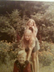 Carol Conkling-Berry, top, is seen with her younger siblings, Sara and Tim, around 1969. Conkling-Berry died in 2018 after battling cancer and mounting medical bills.