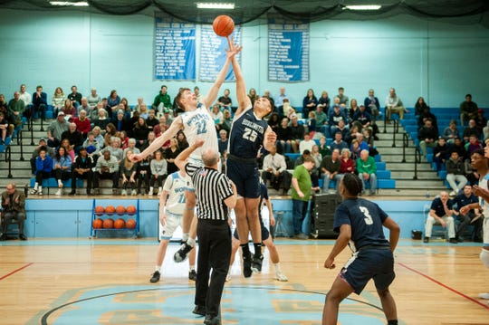 South Burlington's Tyler Gammon (22) and Burlington's Jensen Daly (25) battle for the opening tip off during the boys basketball game between the Burlington Sea Horses and the South Burlington Wolves at South Burlington High School on Friday night December 13, 2019 in South Burlington, Vermont.