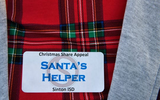 "Eileen Troup wears a ""Santa's helper"" badge during the Caller-Times Children's Christmas Appeal campaign shopping spree, Saturday, Dec. 14, 2019, in Portland. Troup is part of the Sinton for Youth, which is involved with the annual Christmas Appeal."