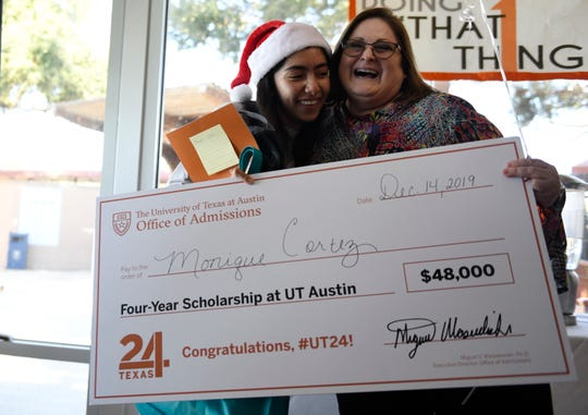 Miller High School student Monique Cortez, left, embraces Miller's Career Counselor Nelda Garcia after receiving a full tuition scholarship to the University of Texas-Austin, Saturday, Dec. 14, 2019. The $48,000 scholarship was given to four students in South Texas and 60 nationwide.