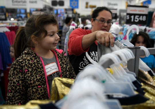 Four-year-old Olivia Heitmann chooses a dress during her Christmas Appeal shopping spree, Saturday, Dec. 14, 2019, in Portland. Heitmann was shopping with her sister Alyssa. The spree is funded through the Caller-Times Children's Christmas Appeal campaign.