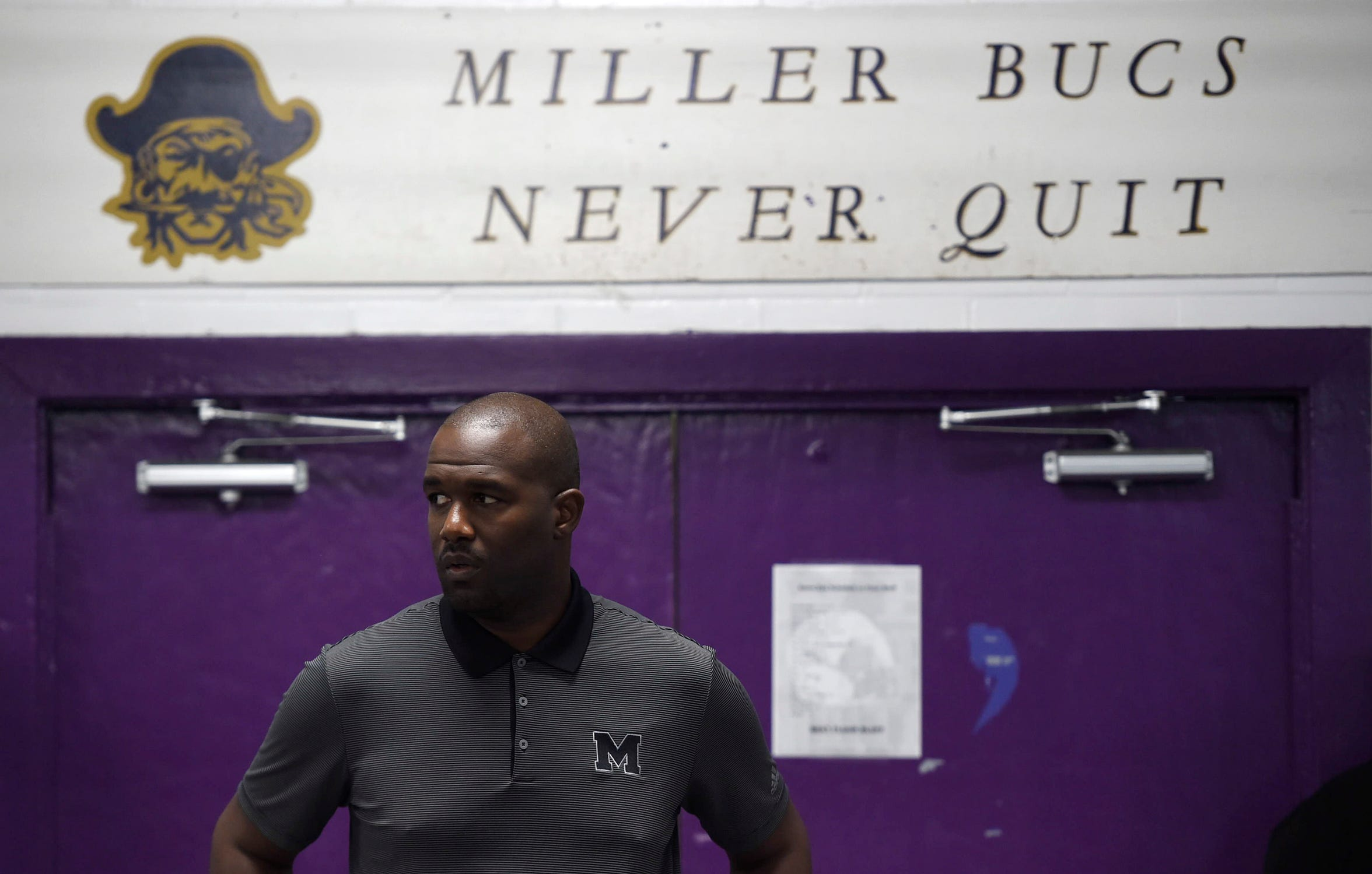"Miller's head football coach Justen Evans pauses at halftime during the game against Flour Bluff, Friday, Oct. 18, 2019, in Miller's locker room. ""There had been years where Miller did have some struggles in football,"" Evans says, ""we some definitely some rough patches over the last decade."""