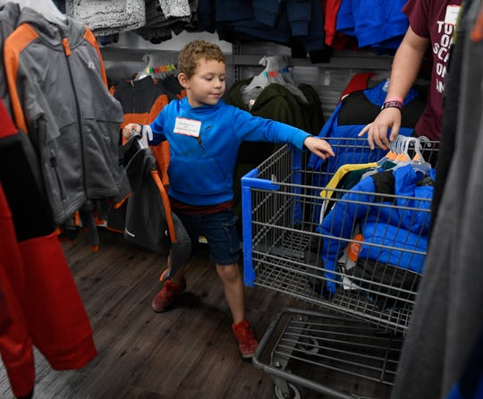 Six-year-old Kaiden Glover picks out clothes during his Christmas Appeal shopping spree, Saturday, Dec. 14, 2019, in Portland. His favorite present was a new pair of shoes. The spree is funded through the Caller-Times Children's Christmas Appeal campaign.