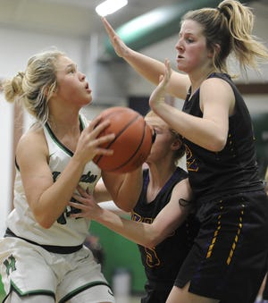 Huntington's Allison Basye goes up for a shot against Unioto on Friday Dec. 13, 2019 at Huntington High School in Chillicothe, Ohio.