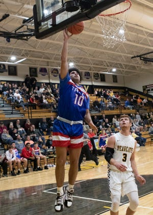 Zane Trace's Cam Evans goes up for a layup against Paint Valley on Friday. The Zane Trace boys basketball team defeated Paint Valley 65-24 on Dec. 13, 2019, in Bainbridge, Ohio.