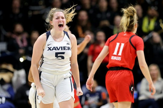 Xavier Musketeers guard Morgan Sharps (5) reacts after scoring a 3-pointer during the second half of a NCAA women's college basketball game against the Cincinnati Bearcats, Saturday, Dec. 14, 2019, at Cintas Center in Cincinnati. Cincinnati Bearcats won 85-78.