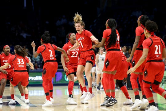 Cincinnati Bearcats guard Sam Rodgers (11), center, celebrates the win at the end of the second half of a NCAA women's college basketball game against the Xavier Musketeers, Saturday, Dec. 14, 2019, at Cintas Center in Cincinnati. Cincinnati Bearcats won 85-78.