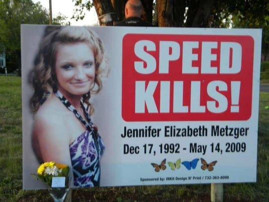 "A ""SPEED KILLS!"" sign has been erected in Jennifer's memory near the site of the crash, part of JEMMS Foundation's mission to promote safe driving"