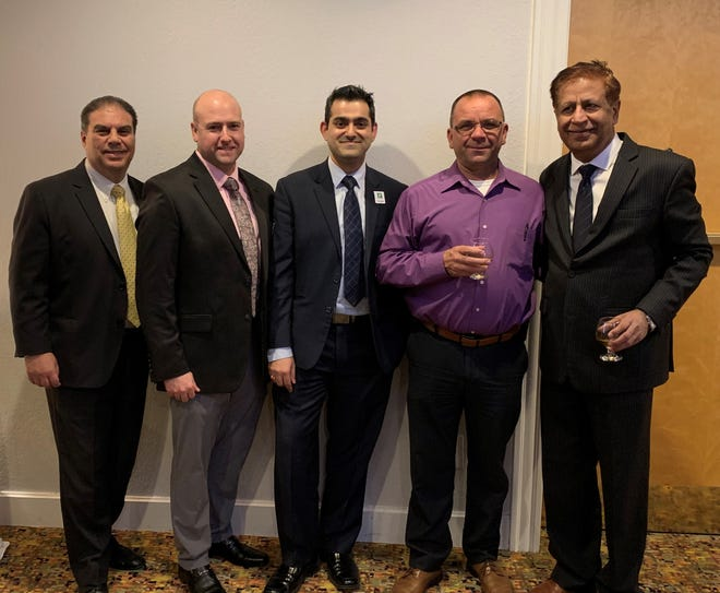 Maurice Alfaro, general manager at Holiday Inn Clinton; Shane Brower, VP of sales at Holiday Inn Clinton; Kkunal Dhupaar, director of sales at Holiday Inn Clinton; Chief Walter Dorf, chief of Clinton Fire Department (Station 45); and Gulshan Chhabra, owner of Holiday Inn Clinton.