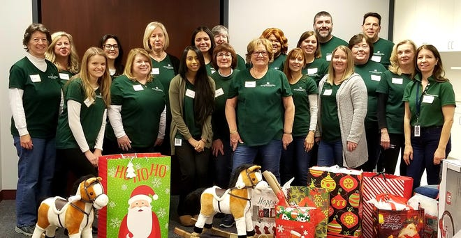 Peapack-Gladstone Bank employees sort holiday gift donations through the United Way of Northern New Jersey Gifts of the Season program