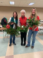 (Left to right)Former Branchburg resident Susanna Duggan, Kathy Moser of Branchburg, and Moser's daughter Lori Sentveld show off their creations made at the Neshanic Garden Club's Green's Workshop.