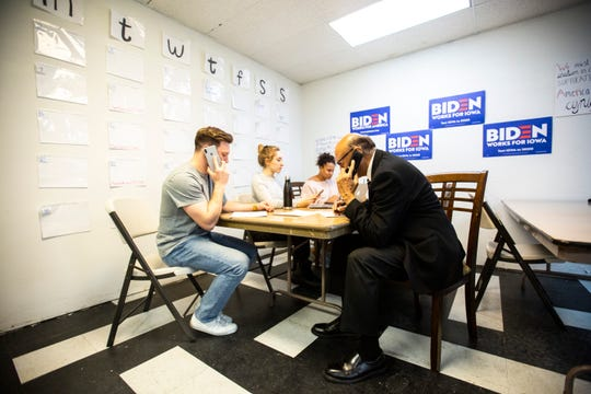 Khizr Khan makes calls with Joe Biden organizers Wes Crew, Emily Levine, and Tate Mitchell, Saturday, Dec. 14, 2019, at a campaign office in Kennedy Plaza in Iowa City, Iowa.