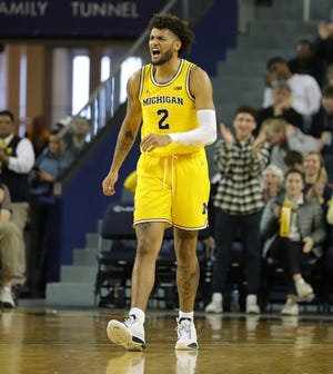 Michigan forward Isaiah Livers reacts after a 3-pointer during U-M's 71-70 overtime loss to Oregon on Saturday, Dec. 14, 2019, at Crisler Center.