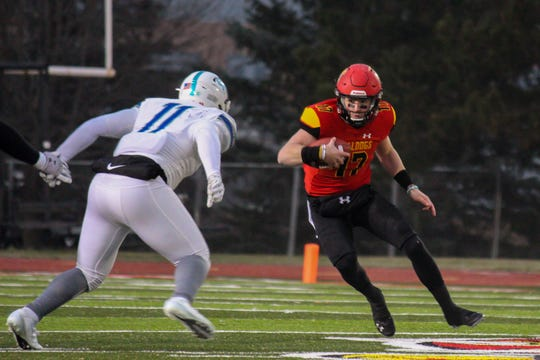 Ferris State quarterback Travis Russell tries to elude a West Florida defender on Saturday, Dec. 14, 2019, in Big Rapids.
