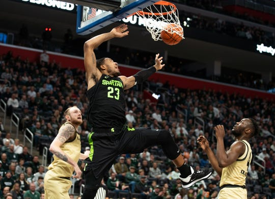 Michigan State forward Xavier Tillman makes a field goal during MSU's 72-49 win over Oakland on Saturday, Dec. 14, 2019, at Little Caesars Arena.