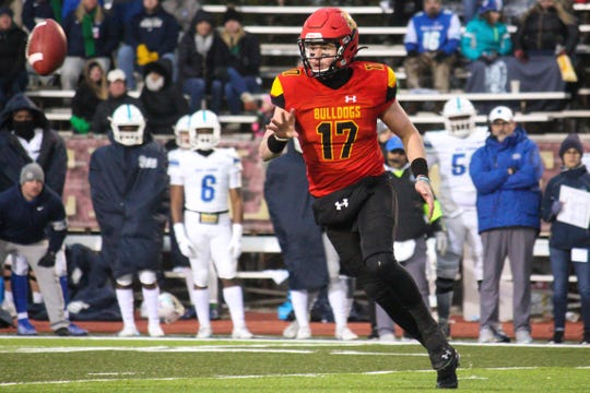 Ferris State quarterback Travis Russell pitches the ball against West Florida on Saturday, Dec. 14, 2019, in Big Rapids.
