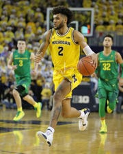 Michigan forward Isaiah Livers drives during U-M's 71-70 overtime loss to Oregon on Saturday, Dec. 14, 2019, at Crisler Center.
