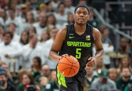 Michigan State guard Cassius Winston (5) dribble the ball during the game against Oakland at Little Caesars Arena in Detroit, Saturday, Dec. 14, 2019. Michigan State won, 72-49.