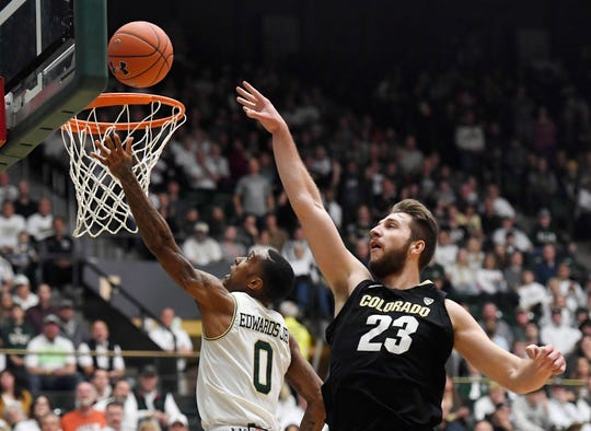 Colorado State guard Hyron Edwards, left, goes for a basket as Colorado forward Lucas Siewert defends in the second half.