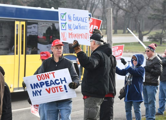 "Republican supporters gathered along Woodward Avenue at a ""No Impeachment"" rally."