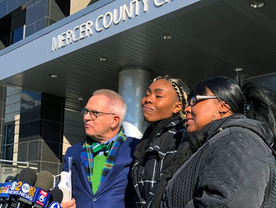 Jazmine Headley, center, joins attorney Brian Neary and her mother, Jacqueline Jenkins, Dec. 12 outside a courthouse in Trenton, N.J., after she accepted a deal to enter a pretrial intervention program related to credit card theft charges she faced.