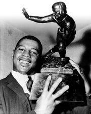 Ernie Davis celebrates winning the Heisman Trophy on Nov. 28, 1961.