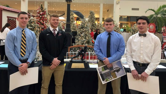 The 2019 Ernie Davis Award nominees pose with Davis' Heisman Trophy during a ceremony Dec. 14, 2019 at the Arnot Mall in Horseheads. The nominees, from left: Elmira Notre Dame's Erik Charnetski, Elmira's Nate Latshaw, Thomas A. Edison's Jack Hourihan and Horseheads' Gavin Elston.