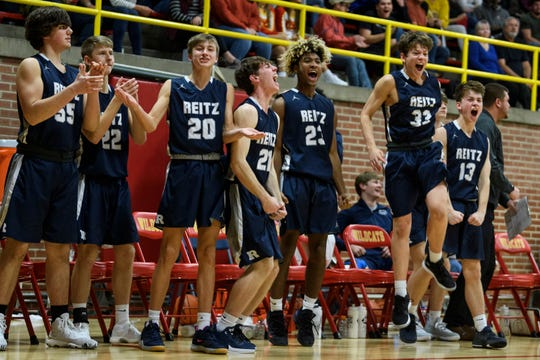 The Reitz Panthers bench reacts as their team widens their lead over the Mater Dei Wildcats at Mater Dei High School in Evansville, Ind., Friday, Dec. 13, 2019. The Panthers made a huge comeback in the fourth quarter to defeat the Wildcats, 79-73.