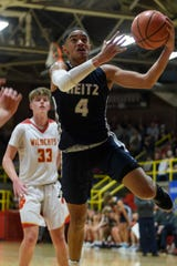 Reitz's Khristian Lander (4) drives to the net during the second quarter against the Mater Dei Wildcats at Mater Dei High School in Evansville, Ind., Friday, Dec. 13, 2019.
