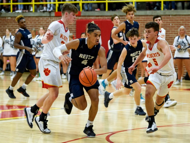 Reitz's Khristian Lander (4) drives the ball to the net during the third quarter against the Mater Dei Wildcats at Mater Dei High School in Evansville, Ind., Friday, Dec. 13, 2019. The Panthers made a huge comeback in the fourth quarter to defeat the Wildcats, 79-73.