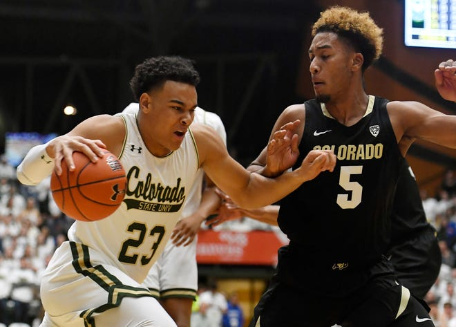 Colorado State Rams guard John Tonje (23) dribbles around Colorado Buffaloes guard D'Shawn Schwartz (5) in the first half of the basketball game at Colorado State University in Fort Collins, Colo. on Friday, Dec. 13, 2019.