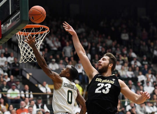 Colorado State Rams guard Hyron Edwards (0) goes for a lay up as Colorado Buffaloes forward Lucas Siewert (23) defends in the second half of the basketball game at Colorado State University in Fort Collins, Colo. on Friday, Dec. 13, 2019.