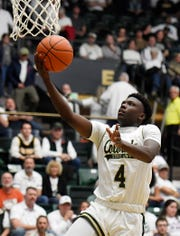 Colorado State men's basketball guard Isaiah Stevens, shown shooting a layup in a Dec. 13 home game against Colorado, scored 26 points Saturday to lead the Rams to a 111-104 triple-overtime win over Tulsa at the BOK Center in Tulsa, Okla.