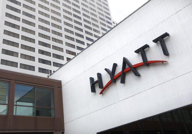 This March 31, 2011, photo shows the Minneapolis downtown Hyatt Regency in Minneapolis. A Wisconsin school district has put a staff member on leave after some students from Madison East High School found recording devices in their hotel rooms during a field trip to Minneapolis. The students stayed at the Hyatt Regency.