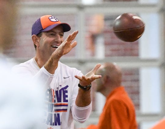 Clemson Head Coach Dabo Swinney catches a pass during practice at the Poe Indoor Facility in Clemson Friday, December 13, 2019. The Tigers are preparing for the College Football Playoffs semi-final game with Ohio State University played in Glendale, Arizona on December 28, 2019.