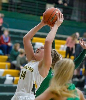 CMR's Allie Olsen attempts a shot in Friday's basketball game against Glacier.