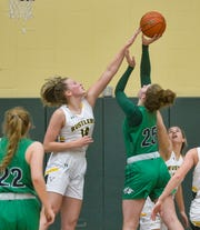 CMR's Allie Olsen attempts to block the shot of Glacier's Emma Anderson during Friday night's game in the CMR Fieldhouse.