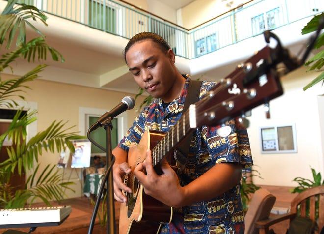 "Local artist University of Guam student, Pedro Blas, performs an original song during ""Nihi Ta Hasso: Desde un klåsen pinadesi esta i otro klåsenna pinadesi"" at UOG in Mangilao, Dec. 14, 2019."
