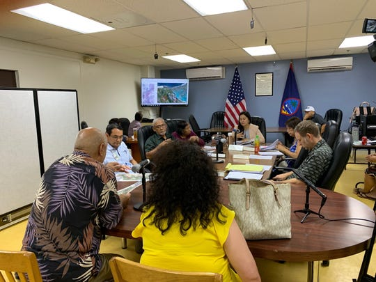Department of Public Works Chief Engineer Masoud Teimoury, left, on Friday tells the CHamoru Land Trust Commission about a proposal to open access to Land Trust properties in exchange for the temporary use of land at Oka Point.