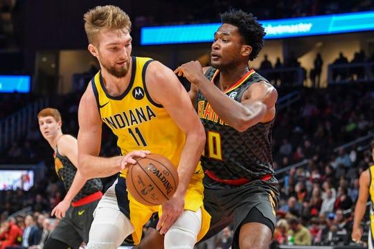 Indiana Pacers forward Domantas Sabonis (11) drives against Atlanta Hawks center Damian Jones (30) during the first half at State Farm Arena.