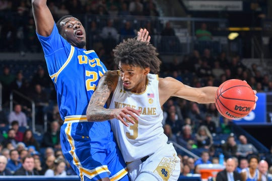 Notre Dame Fighting Irish guard Prentiss Hubb (3) drives to the basket as UCLA Bruins guard Prince Ali (23) defends in the second half at the Purcell Pavilion.