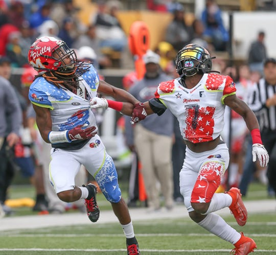 Alabama's Korian Wilson (7) holds Mississippi's Lideatrick Griffin (5) during the Mississippi-Alabama All-Star football game on Saturday, Dec. 14, 2019 at M.M. Roberts Stadium at the University of Southern Mississippi. Griffin has signed to play football with Mississippi State.