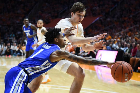 Tennessee's Drew Pember (3) and Memphis' Tyler Harris (1) chase after the ball during a basketball game between Tennessee and Memphis at Thompson-Boling Arena in Knoxville, Tenn., on Saturday, December 14, 2019.