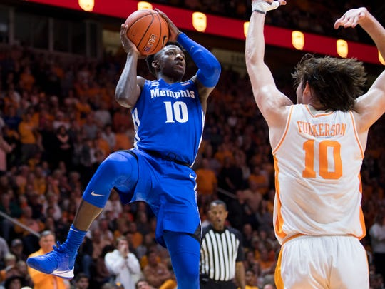 Memphis guard Damion Baugh (10) attempts a shot over Tennessee forward John Fulkerson (10) during a basketball game between Tennessee and Memphis at Thompson-Boling Arena in Knoxville, Tenn., on Saturday, December 14, 2019.