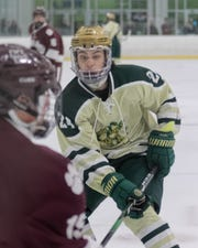 Howell's Brent Wolf chases after a puck in a 4-1 loss to Detroit U-D Jesuit on Saturday, Dec. 14, 2019.