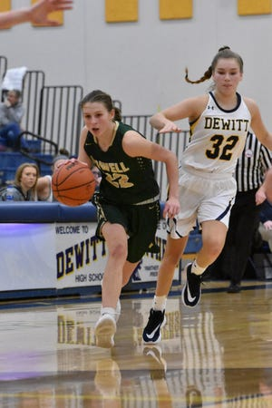 Howell sophomore Maeve St. John (22) scored 26 points and grabbed 6 steals in a 50-46 overtime victory at DeWitt on Friday, Dec. 13, 2019.